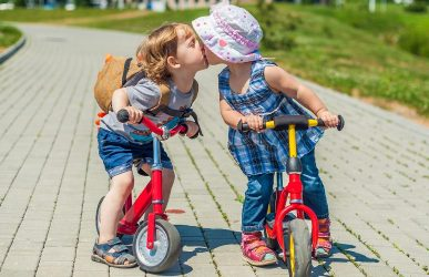 Two kids on balance bike